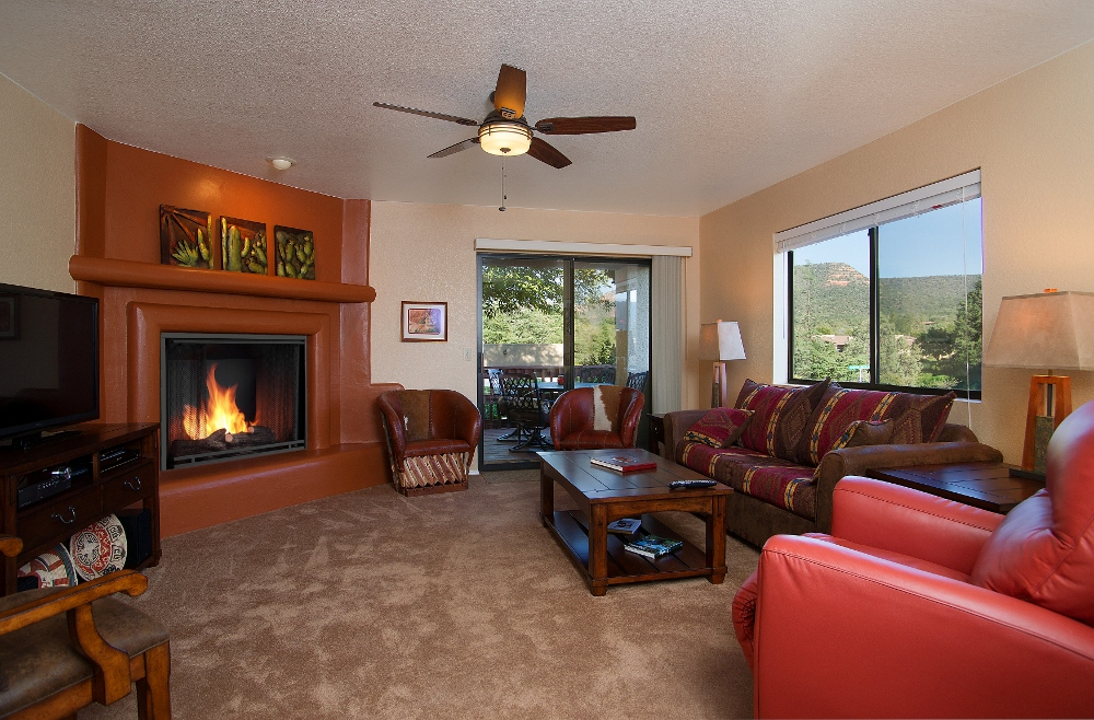 Comfy  Cozy living room with fireplace for the cool desert nights.